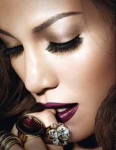 champagne shimmer + falsies, deep plum lips and amazing contouring and highlighting.