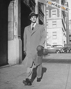 Elegant Man Walking Alone Along City Street Stock Photos