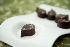 "An aromatic traditional ""paan"" dark chocolate truffle made with rose preserves, betel nut leaves and fragrant spices without the tobacco! Chockriti Chocolates"