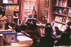 """Bookshop in """"You've Got Mail""""; wood trim+golden beige+cheerful colors"""