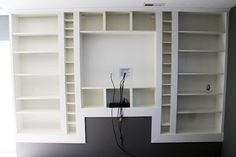 Billy bookcases-making look built in, including disparate pieces. Review for Project Alexandria.
