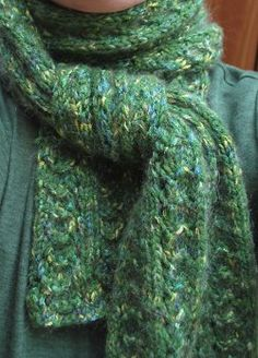 Free knitting pattern for Peacock Scarf.  Stay warm this winter with this cozy scarf pattern.