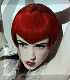 edgy-short red bob with chevron bang