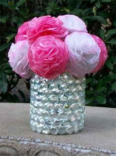 Flower vase made from a mayonnaise jar and clear marbles
