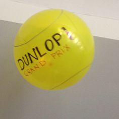Blow up balloons and decorate like tennis balls when decorating for a tennis lover