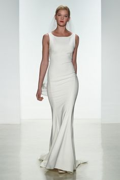 "Amsale Spring 2015 ""Heather"" gown. Heavy crepe slim fit to flare gown with bateau neckline and sheer back with covered buttons from neckline to hem #amsale #bridal #nitsas"