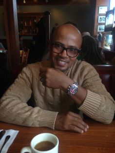 Derrick Hicks shows off his Omega Speedmaster Racing Co-Axial Chronograph.