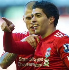 Luis Suarez celebrates with Martin Skrtel after scoring against Stoke in the FA Cup