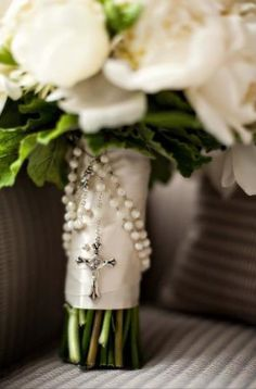 Rosary on bride's bouquet.