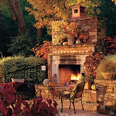 This freestanding patio fireplace creates an instant cozy gathering place. The mantel is decorated with a row of tea lights for extra sparkle when the sun goes down.