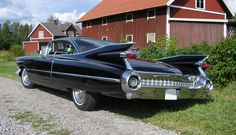 59' Cadillac, on a gravel road, in front of a red barn. Simpler times!