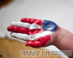 4th of July Craft: Paint the flag backwards on your hand and stamp it on a shirt, decoration or whatever!