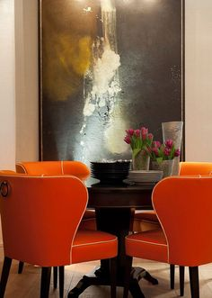 Dining Room - Dark wood round table with orange chairs