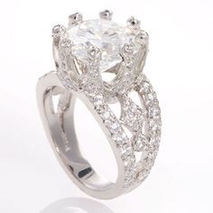 Holy crap! Platinum Queen ring with diamond accents and round-cut center stone