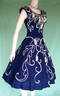 50's cocktail dress - I would totally wear this.