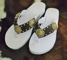 Hair on hide western bling concho flip flops. Size 9/10 $35.00  www.pamperedcowgirl.com