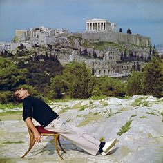 The photographer Slim Aarons lounges by the Acropolis, circa 1955.