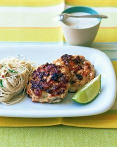 Asian Salmon Patties. Ingredients    1 1/2 pounds skinless salmon fillet, finely chopped  2 shallots, minced  2 tablespoons grated peeled fresh ginger  1 large egg, lightly beaten  1/4 to 1/2 teaspoon crushed red pepper  Coarse salt and ground pepper  Lime wedges, for serving (optional)  1/3 cup reduced-fat mayonnaise  2 thinly sliced scallions  2 tablespoons fresh lime juice  1 teaspoon toasted sesame oil