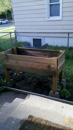 Raised garden from re-purposed materials.