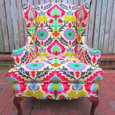 how amazing is this chair?   bright colors that make a statement and kind of remind me of my grandmother?  yes, please :)
