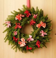Bow ties adorn an evergreen wreath. How-to and more ideas: http://www.midwestliving.com/homes/seasonal-decorating/beautiful-holiday-wreaths/?page=18,0