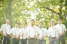 The groom and his groomsmen sported gray suspenders with orange bow ties. |   Photo by Dust Studios