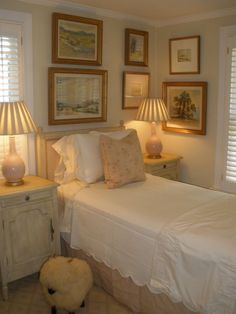 BED NEXT TO WINDOW- Styling up a small room with twin bed and gallery art