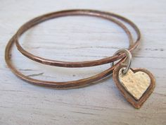 Hand forged copper bangles with a dangling hand cut copper and sterling silver heart for your valentine by JoDeneMoneuseJewelry, $48.00