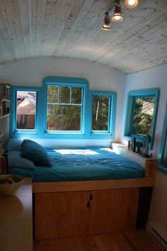 Gorgeous bed in a mobile home.