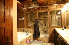 rustic luxury bathroom.  I love how the walk in shower is set up, I even like the windows. This room doesn't feel huge. I like that too.