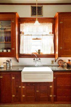 Original cabinets in a restored Craftsman kitchen.