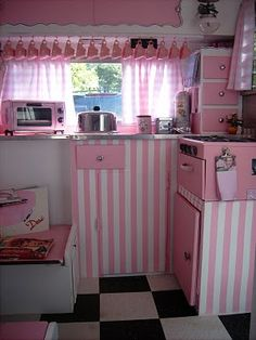 sweet lil' kitchen...with adorable pink cups all in a row...ahhh adorable...
