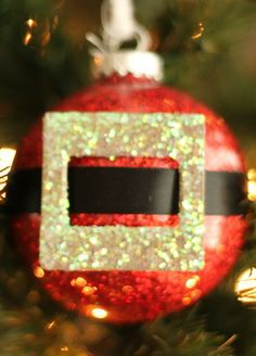 Try out this fun DIY Glitter Santa Ornament for Christmas!