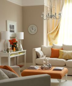 Neutral living room with orange and pale yellow accents