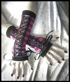 Cheshire Grin Gothic Lolita Corset Style Arm Warmers - Mauvey Purple & Pink Stripes Laced Up - Black Ribbon - Belly Dance Goth Victorian Emo. $30.00, via Etsy.