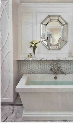 Bathroom. Love the molding detail.