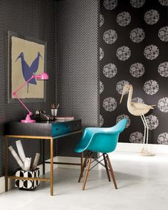 Beautiful aqua midcentury modern chair mixed in this b/w decor.