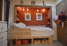 bunk beds and storage- love the orange!