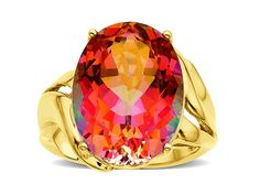 A hand-sculpted 14K gold band proudly displays a dazzling stone to its best effect for a dramatic cocktail piece. A 15 1/2 ct azotic ecstays mystic topaz lights up the face of this ring with an explosion of riotous colour and dazzle!