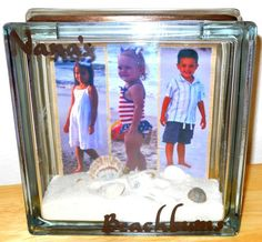 This is an AWESOME gift my daughter and grandchildren made for me. A glass block with pics of my grandchildren and the sand and seashells they collected while visiting me in Florida. gift, glass block