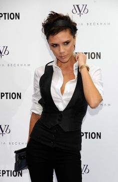 Victoria Beckham presents new jeans collection...just bought her perfume the other day...<3 her style..wearing this right now but with a black skirt and knee socks!! :)