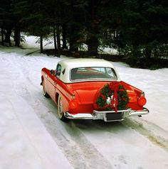 Red beauty in the snow. ♥ this car