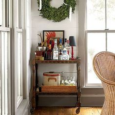 Classic Portable Bar | In one corner of the dining room, a rolling cart holds a full bar all set for holiday entertaining. | SouthernLiving.com