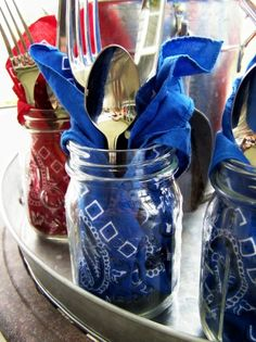 Mason jars filled with napkins & silverware for guests.  Can add name tags.