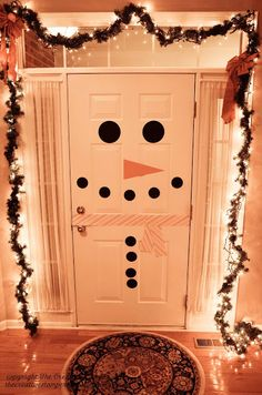 Pins to Creation Post - Snowman Door   ..... A lot like the refrigerator door.  Makes ya' smile!