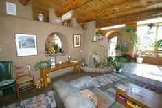Interior.  Open floor plan.  Earthships: a home from recycled and reclaimed materials ...