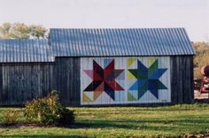 """quilt barns: Apparently this grass roots art movement began in 2001 and has spread to 16 states and 900 barns, adopted by rural communities as a way to honor the craft of quilt making and farming expressed through public art. Ohio, Iowa and Kentucky have over 250 in each state. Many barns are part of """"quilt trails"""" that map dozens of barns per trail that sightseers can follow and enjoy."""
