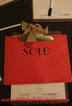 """We are considering trying this next year Neat way to show that item is """"SOLD"""" at the guaranteed price!!!! Raise More Funds at your benefit auction"""