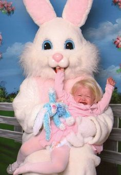 don't think she looks too happy to b with mr easter bunny
