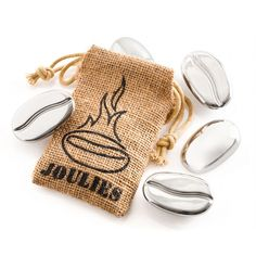 Coffee Joulies 5-Pack  //  Each polished stainless steel shell is filled with a special phase change material that melts at 140°F. Put them inside your coffee and they absorb heat when it is too hot and release it back into your coffee to keep it at the perfect temperature. The 5-Pack works with up to 20 oz of coffee, one bean per 4 oz.